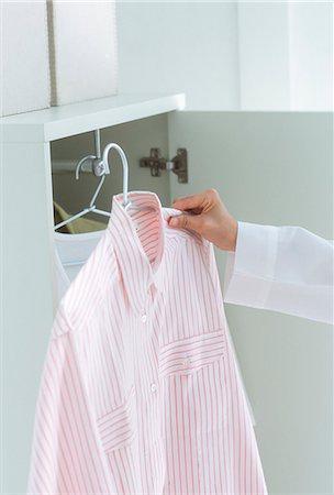 Human Hand Picking Shirt Stock Photo - Premium Royalty-Free, Code: 622-06009779