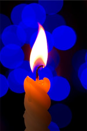 Single Candle Flame Stock Photo - Premium Royalty-Free, Code: 622-06010004