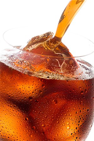 Drink Pouring Into Glass Stock Photo - Premium Royalty-Free, Code: 622-06010100