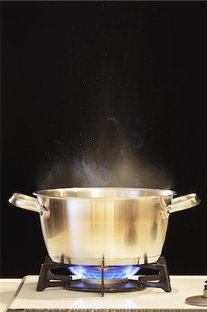 stove - Lit Gas Stove With Pot Stock Photo - Premium Royalty-Free, Code: 622-06163815