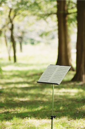 sheet music - Close Up Of Music Stand With Sheet Music In Park Stock Photo - Premium Royalty-Free, Code: 622-06163915