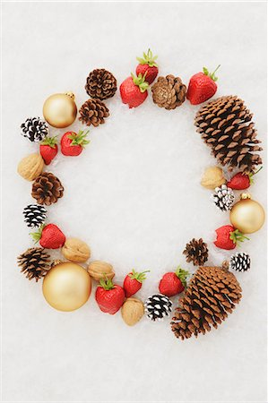 Fruits, Dry Fruits And Baubles With White Background Stock Photo - Premium Royalty-Free, Code: 622-06163992