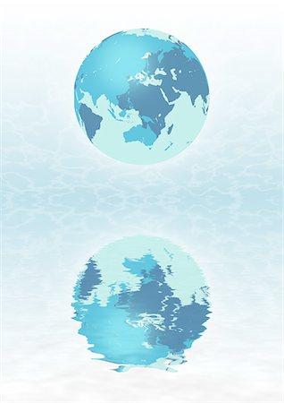 Globe Model Reflecting In Water Stock Photo - Premium Royalty-Free, Code: 622-06190962