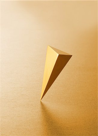 solid - Triangular gold pyramid Stock Photo - Premium Royalty-Free, Code: 622-06370029