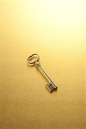 Gold key Stock Photo - Premium Royalty-Free, Code: 622-06370035