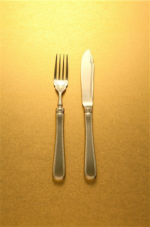 fork - Gold knife and fork Stock Photo - Premium Royalty-Free, Code: 622-06370038