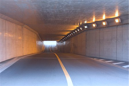 Lighted tunnel under the highway Stock Photo - Premium Royalty-Free, Code: 622-06439279