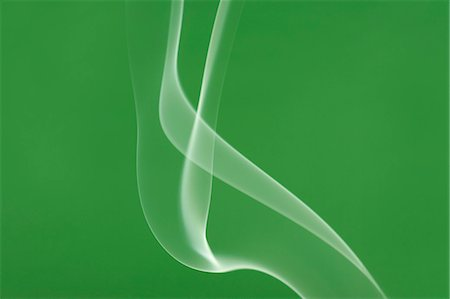 flowing - White smoke on green background Stock Photo - Premium Royalty-Free, Code: 622-06486780