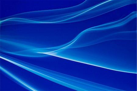 smoke - White smoke on blue background Stock Photo - Premium Royalty-Free, Code: 622-06548901