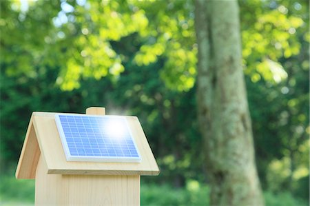 solar power - Miniature wooden house with solar panels Stock Photo - Premium Royalty-Free, Code: 622-06809715