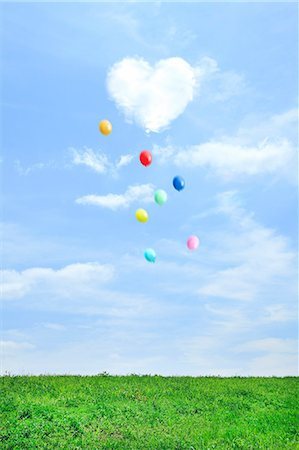 fluffy - Grassland and sky with flying balloons and heart-shaped cloud Stock Photo - Premium Royalty-Free, Code: 622-06842536