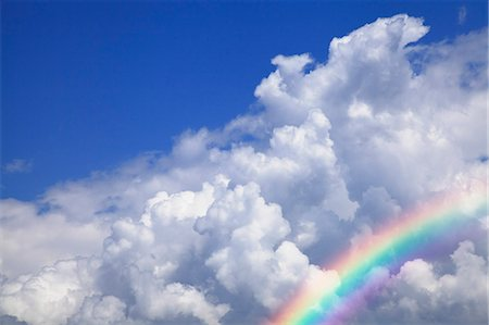 Blue sky with clouds and rainbow Stock Photo - Premium Royalty-Free, Code: 622-06842630