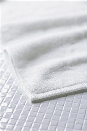 fluffed - White towel on tiled floor Stock Photo - Premium Royalty-Free, Code: 622-06964240