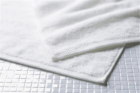 White towels on tiled floor Stock Photo - Premium Royalty-Free, Code: 622-06964241