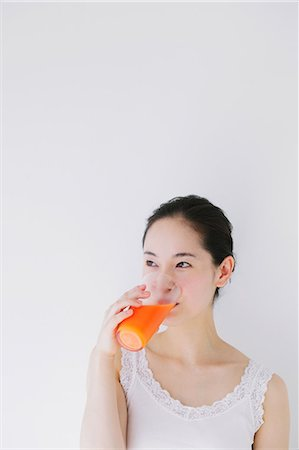 Young woman drinking vegetable juice Stock Photo - Premium Royalty-Free, Code: 622-06964262