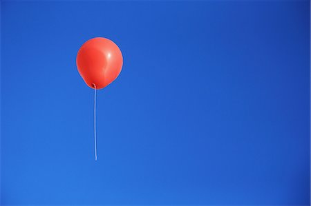 Balloon flying in the blue sky Stock Photo - Premium Royalty-Free, Code: 622-06964392