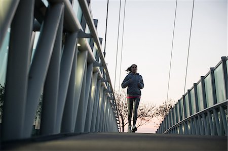 dynamic - Young Girl Running On A Bridge Stock Photo - Premium Royalty-Free, Code: 622-07736002