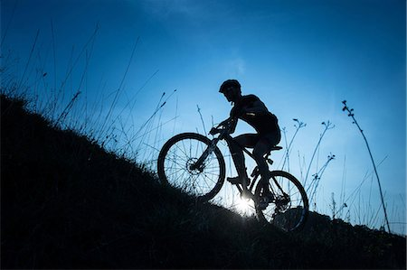 Man riding mountain bike in nature in the Bologna countryside, Italy Stock Photo - Premium Royalty-Free, Code: 622-07736013
