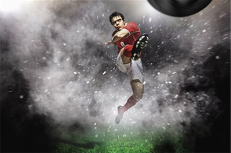 spike - Soccer Player Kicking The Ball In Mid-Air Stock Photo - Premium Royalty-Free, Code: 622-07736026