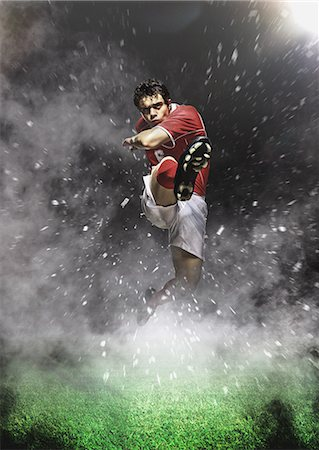 dynamic - Soccer Player Kicking In Mid-Air Stock Photo - Premium Royalty-Free, Code: 622-07736027