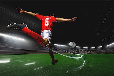 Soccer Player Kicking The Ball Stock Photo - Premium Royalty-Free, Code: 622-07736028
