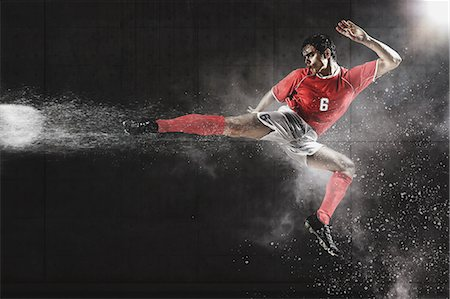 spike - Soccer Player Kicking The Ball In Mid-Air Stock Photo - Premium Royalty-Free, Code: 622-07736029