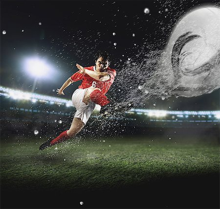 footballeur - Soccer Player Kicking The Ball Stock Photo - Premium Royalty-Free, Code: 622-07736030