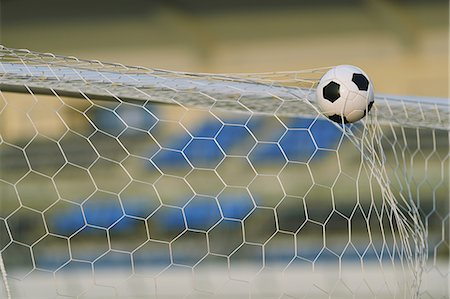 scoring - Soccer ball in the net Stock Photo - Premium Royalty-Free, Code: 622-07736041