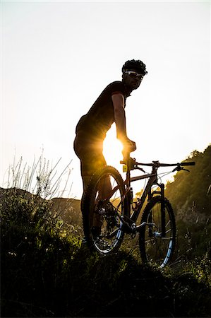 Man riding mountain bike in nature in the Bologna countryside, Italy Stock Photo - Premium Royalty-Free, Code: 622-07736054
