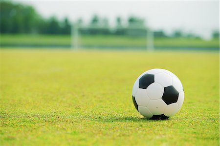 Soccer ball on soccer field Stock Photo - Premium Royalty-Free, Code: 622-07736071