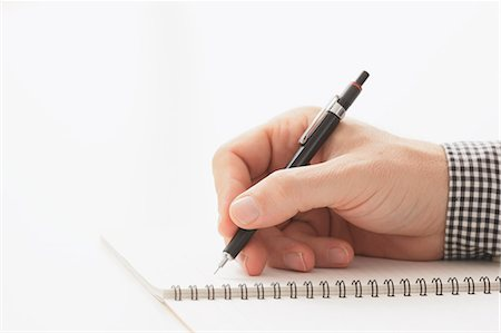 right - Close up of male hand writing on notebook Stock Photo - Premium Royalty-Free, Code: 622-07743528