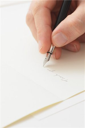 right - Close up of male hand writing on paper Stock Photo - Premium Royalty-Free, Code: 622-07743533