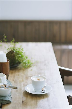 Cappuccino on wooden table in a cafe Stock Photo - Premium Royalty-Free, Code: 622-07743555