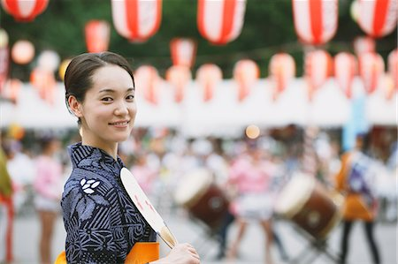 Young Japanese woman in a traditional kimono at a summer festival Stock Photo - Premium Royalty-Free, Code: 622-07743569