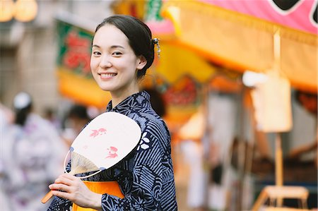 Young Japanese woman in a traditional kimono at a summer festival Stock Photo - Premium Royalty-Free, Code: 622-07743570