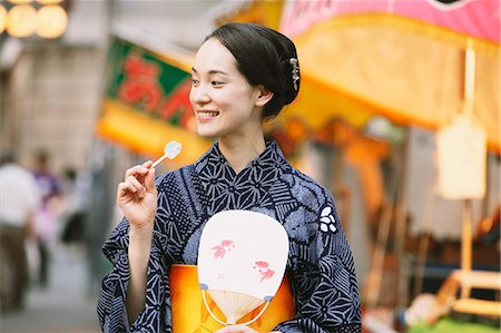 Young Japanese woman in a traditional kimono at a summer festival Stock Photo - Premium Royalty-Free, Code: 622-07743572
