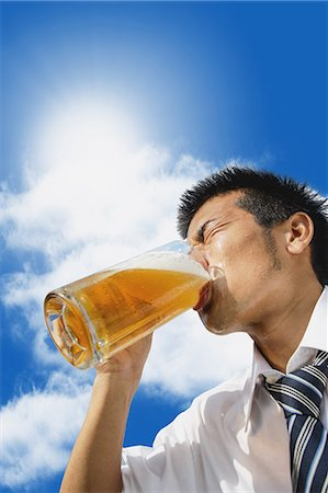 sweaty businessman - Japanese businessman drinking draft beer Stock Photo - Premium Royalty-Free, Code: 622-07810651