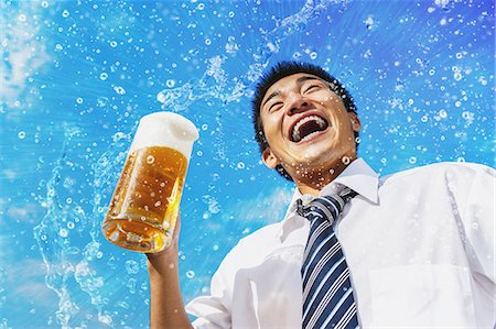 sweaty businessman - Japanese businessman drinking draft beer Stock Photo - Premium Royalty-Free, Code: 622-07810653