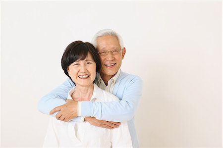Senior adult Japanese couple against white wall Stock Photo - Premium Royalty-Free, Code: 622-07810965