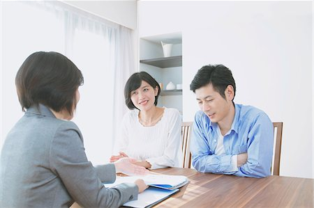 descriptive - Young Japanese couple consulting with financial planner Stock Photo - Premium Royalty-Free, Code: 622-08122700