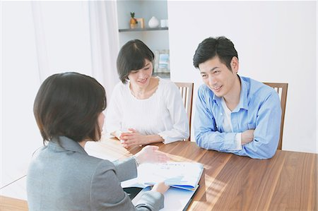 descriptive - Young Japanese couple consulting with financial planner Stock Photo - Premium Royalty-Free, Code: 622-08122701