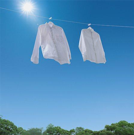 Laundry drying up on washing line Stock Photo - Premium Royalty-Free, Code: 622-08122813