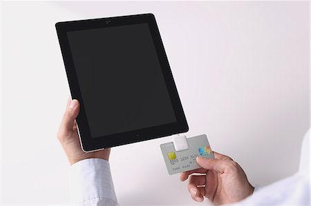 person on phone with credit card - Cashless payment devices Stock Photo - Premium Royalty-Free, Code: 622-08122896