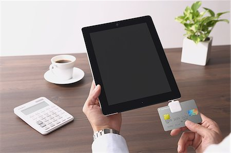 Cashless payment devices Stock Photo - Premium Royalty-Free, Code: 622-08122901