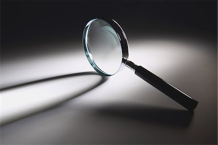 quest - Magnifying glass Stock Photo - Premium Royalty-Free, Code: 622-08122922
