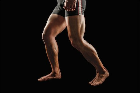 Japanese male athlete showing off muscles Stock Photo - Premium Royalty-Free, Code: 622-08355428
