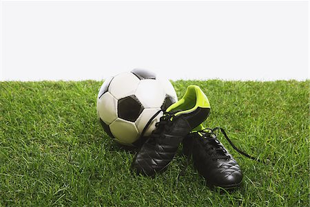 spike - Soccer ball and shoes on grass Stock Photo - Premium Royalty-Free, Code: 622-08355549