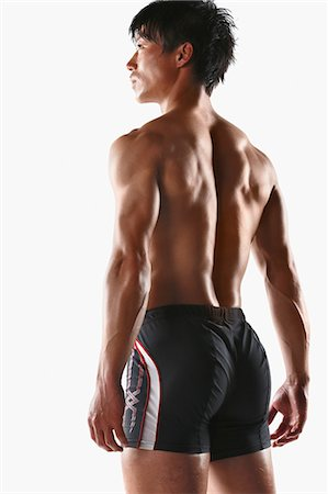 Japanese male athlete showing off muscles Stock Photo - Premium Royalty-Free, Code: 622-08355762