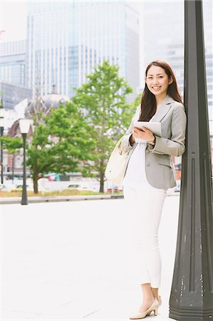Japanese attractive businesswoman in downtown Tokyo Stock Photo - Premium Royalty-Free, Code: 622-08482387