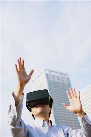 perception - Japanese man using virtual reality device Stock Photo - Premium Royalty-Free, Code: 622-08519684